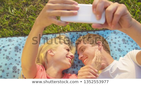 young people on blanket in field Stock photo © IS2