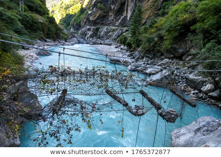 Broken Suspension Bridge in Himalayas Nepal Stock photo © blasbike