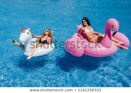 Heureux femme blanche bikini gonflable Photo stock © wavebreak_media