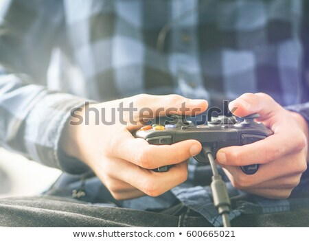 close up of boy with gamepad playing video game Stock photo © dolgachov