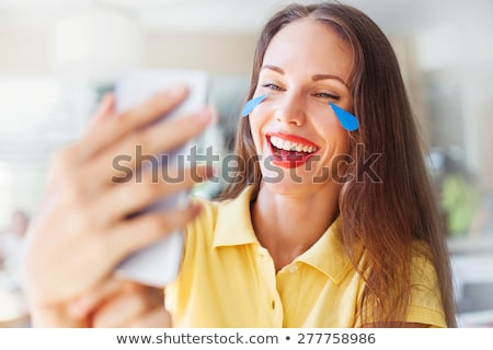 woman laughs with tears stock photo © rogistok