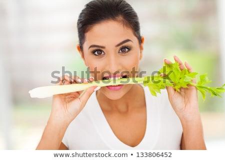 Lány harap zeller bot gyermek konyha Stock fotó © IS2