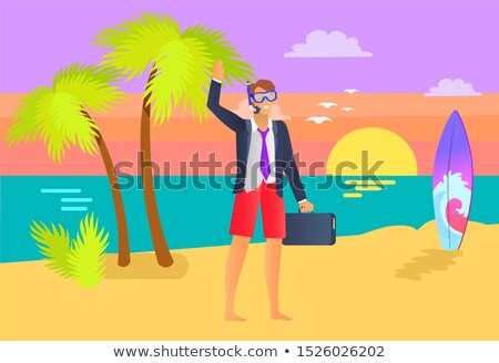 Man Wearing Suit with Briefcase at Seaside, Sunset Stock photo © robuart
