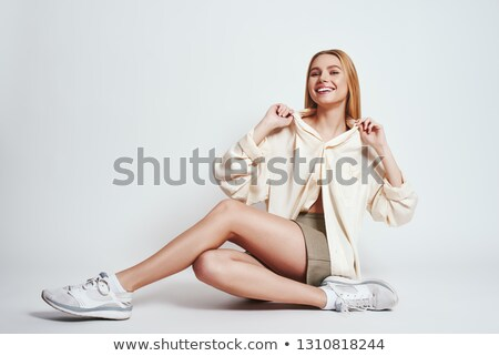 Portrait of a delighted young woman in dress Stock photo © deandrobot