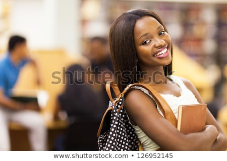 Portrait of a cheerful young african girl with backpack Stock photo © deandrobot