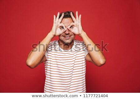 европейский человека полосатый футболки улыбаясь глядя Сток-фото © deandrobot
