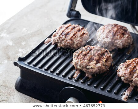 Meat - chicken cutlet to fry on an electric grill Stock photo © TanaCh