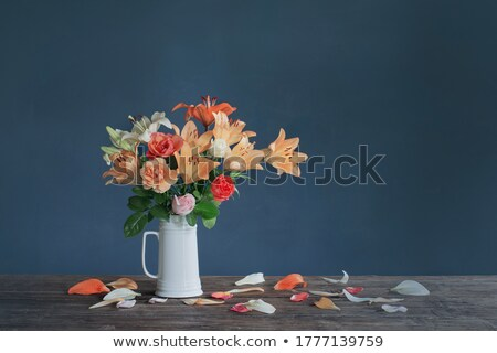 pink lily flowers in the ceramic vase stock photo © colematt