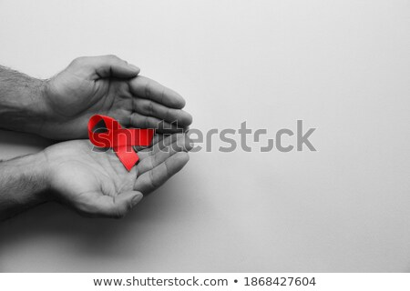 man holding ribbon with hope text stock photo © andreypopov