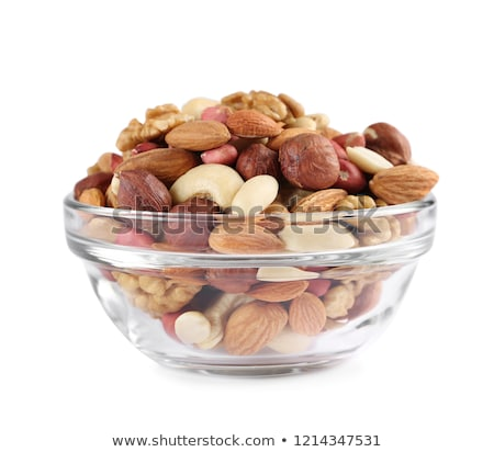 close up of pistachio nuts in glass bowl Stock photo © dolgachov