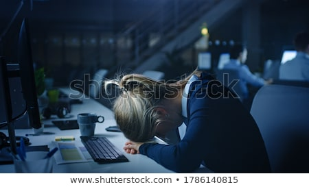 tired businesswoman working at night office stock photo © dolgachov
