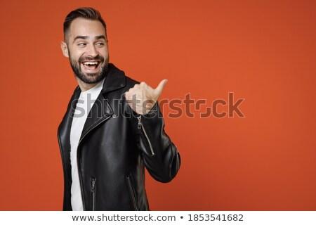 Sorridente casual homem jaqueta de couro pontos Foto stock © feedough