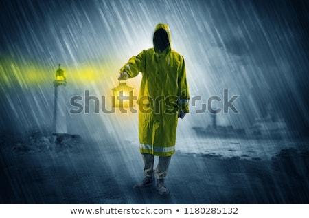 Férfi lámpás part esőkabát izzó eső Stock fotó © ra2studio