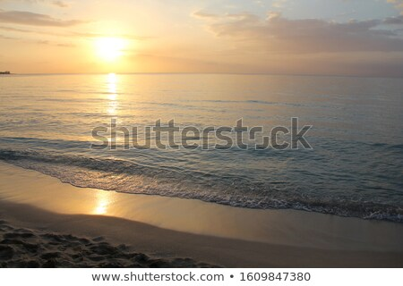 Sun sets on Seven Mile Beach Stock photo © jsnover