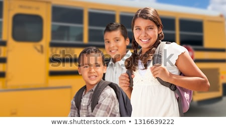 Young Hispanic Students with Blank Chalkboard Near School Bus Stock photo © feverpitch
