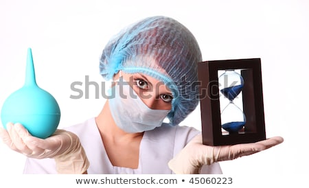 Nurse with clyster and sandglass Stock photo © Massonforstock