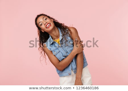 Portrait of a pretty african woman dressed in denim vest Stock photo © deandrobot