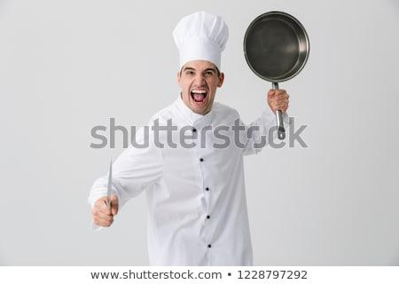 érzelmes fiatalember szakács bent izolált fehér Stock fotó © deandrobot