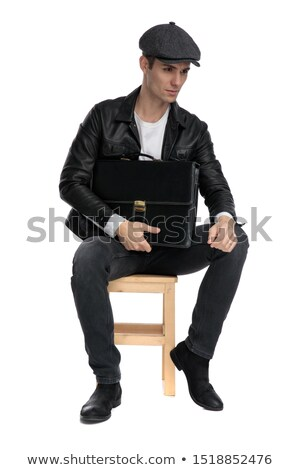handsome fashion man in leather jacket and hat dreaming away  Stock photo © feedough