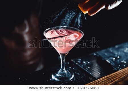 barman at work preparing cocktails pouring martini to cocktail stock photo © dashapetrenko