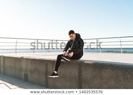 Image actif Guy 20s survêtement up Photo stock © deandrobot