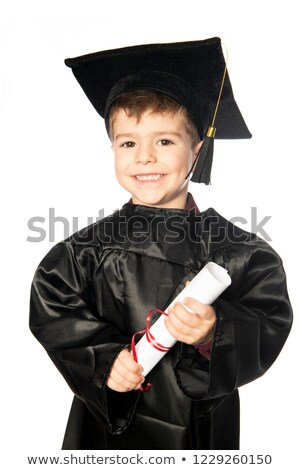 A Young boy 4 years old in graduation dress for the nursery class Stock photo © Lopolo