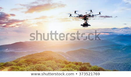multicopter drone flying in the sky Stock photo © unkreatives
