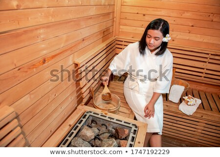 Young woman leaving sauna Stock photo © nyul