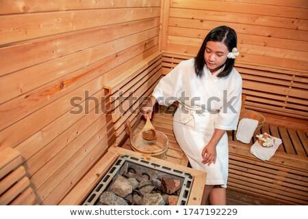 young woman leaving sauna stock photo © nyul