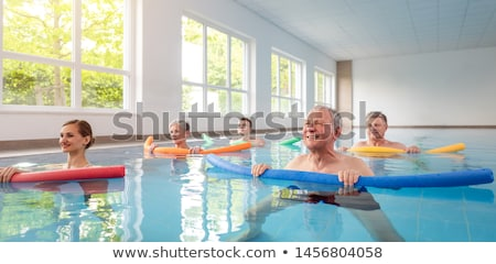 women and men in water exercises during remobilization stock photo © kzenon