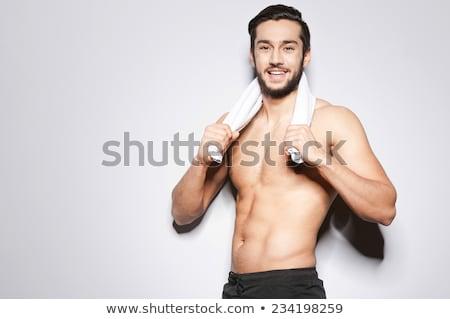 smiling indian man with towel Stock photo © dolgachov