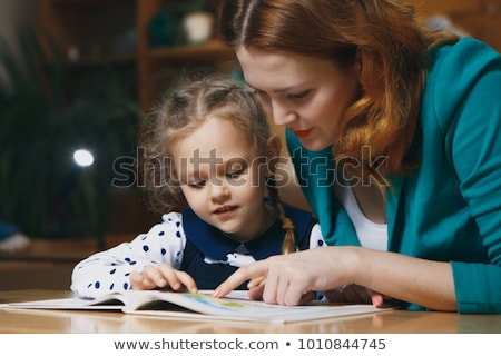 happy student girl doing homework at home stock photo © dolgachov