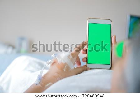 Senior woman with Covid-19 phone app Stock photo © Kzenon