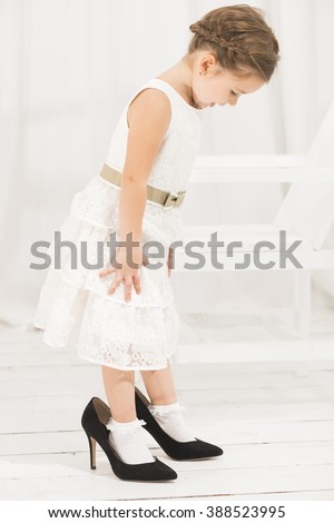 little girl wearing black clothes and black shoes stock photo © phbcz