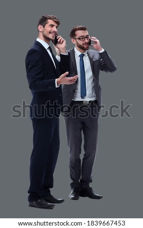 Two businesspeople using their mobile telephones Stock photo © photography33