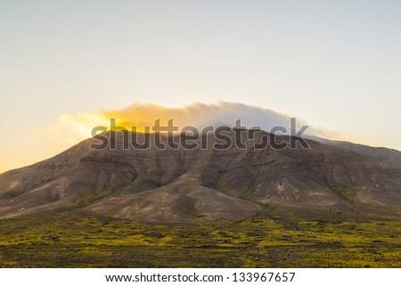 sunrise over Femes mountains seen from Playa Blanca, Lanzarote Stock photo © meinzahn