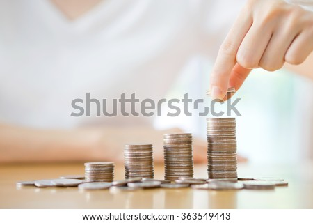 Businesswoman Hand Put Coins To Stack Of Coins Stock photo © AndreyPopov