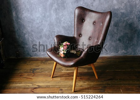 bridal bouquet on a leather brown armchair Stock photo © ruslanshramko