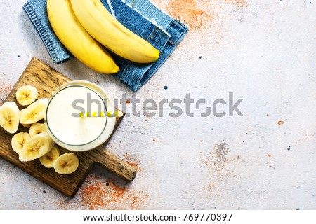 fresh bunch of bananas on wooden table stock photo © nalinratphi