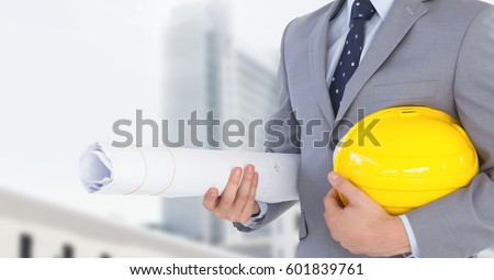 Stock photo: Architect Torso holding a cask in the street