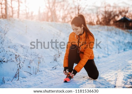 Running woman on winter trail, snow and white mountains Stock photo © blasbike