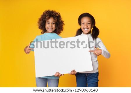 happy children holding sign yellow stock photo © colematt