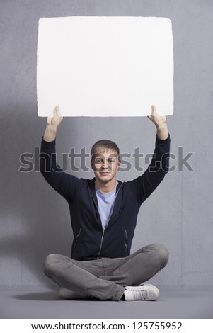 Likable man presenting white empty signboard. Stock photo © lichtmeister