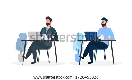 a man is sitting in a chair in the office at the table stock photo © traimak