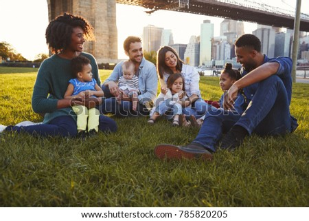 front view of multi ethnic group of friends relaxing and sitting on beach while interacting with eac Stock photo © wavebreak_media