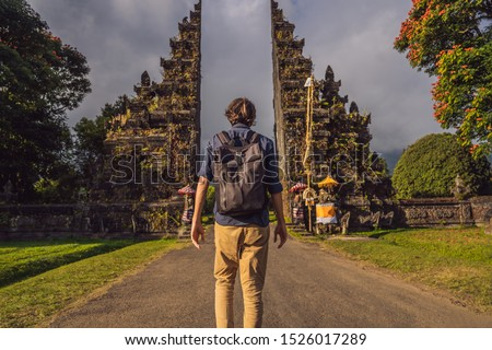Tourist man walking through Traditional Balinese Hindu gate Candi Bentar close to Bedugul, Bratan la Stock photo © galitskaya