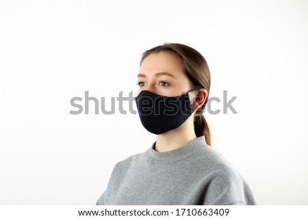 Young woman wearing a black face mask Stock photo © Giulio_Fornasar