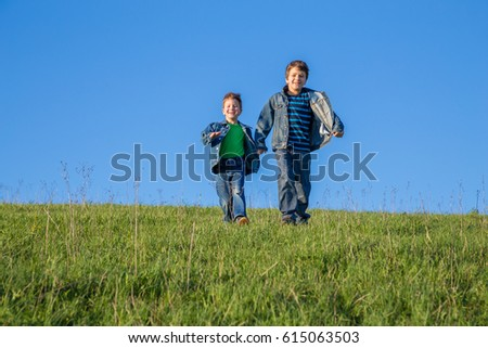 two boys on hill in countryside stock photo © is2