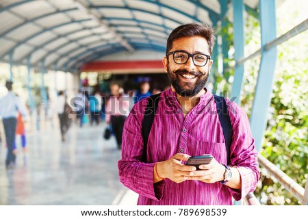 man using his smartphone in a station or airport stock photo © nito