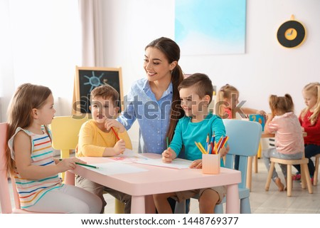 Group of children and teacher playing in kindergarten Stock photo © Kzenon